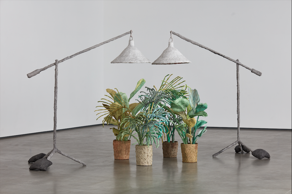 Evan Holloway, Plants and Lamps (2015). Steel, cardboard, aqua-resin, epoxy, resin, fiberglass, sandbags, Celluclay, paint. Overall (installation variable): 89 x 82 x 38 inches. Image courtesy of David Kordansky Gallery, Los Angeles, CA. Photo: Lee Thompson.