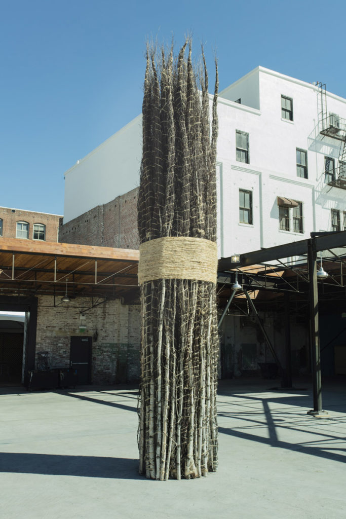 Jackie Winsor, 30 to 1 Bound Trees (1971-1972/2016). Wood and hemp, 20 x 5 x 5 feet. Image courtesy of the artist and Hauser Wirth & Schimmel.