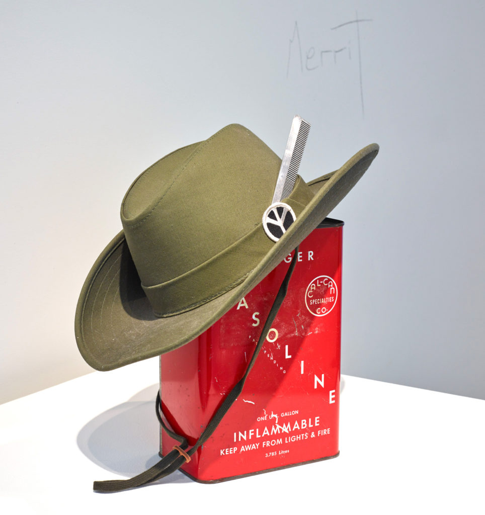 Eleanor Antin, Merrit (1969). Gasoline can, hat with fabric patch, comb, dimensions variable. Image courtesy of the artist and Diane Rosenstein, Los Angeles.
